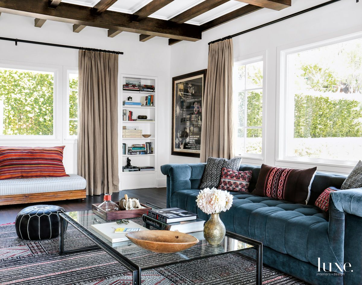Eclectic White Living Room with Low-Slung Sofa