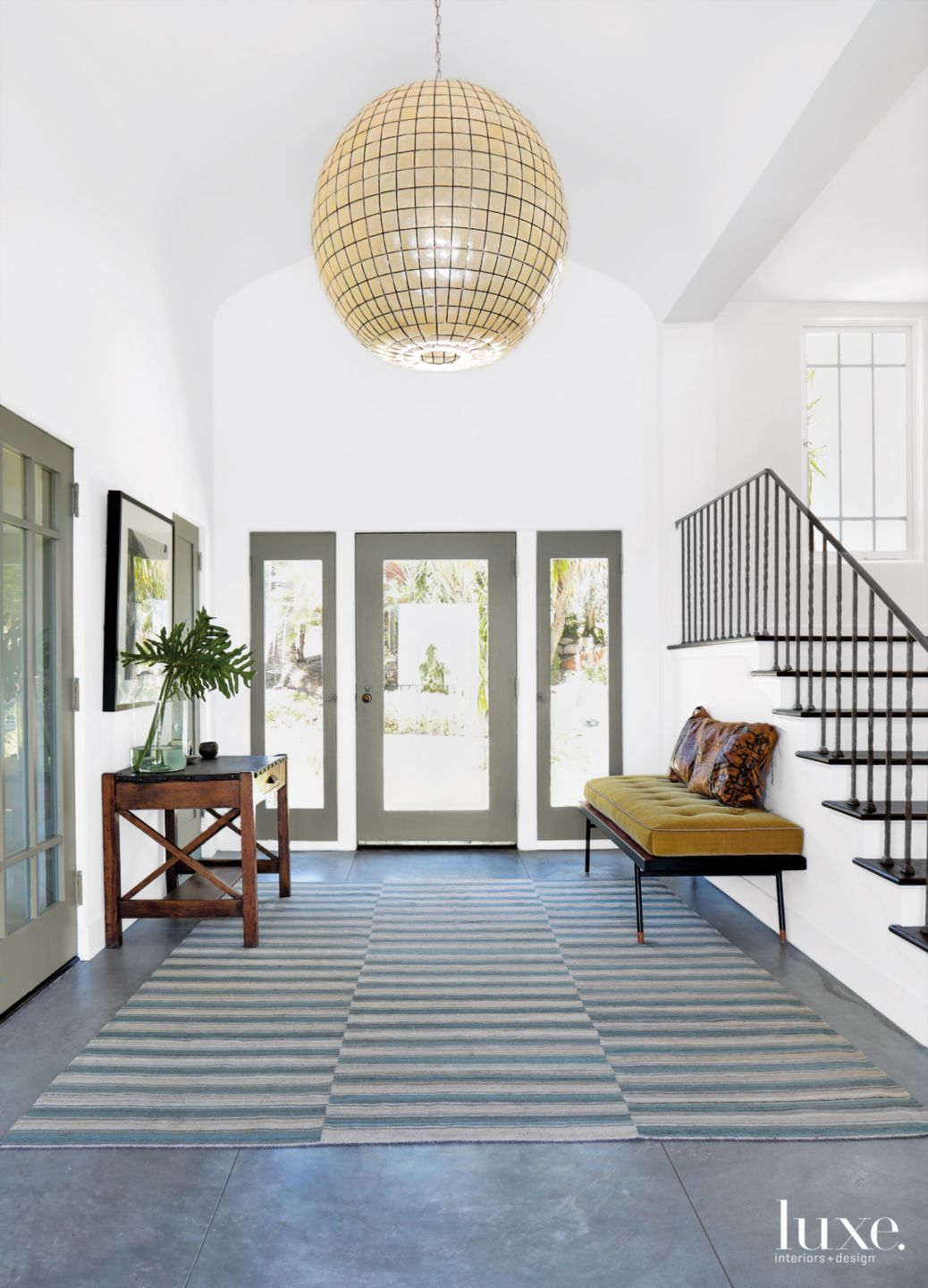 Eclectic White Foyer with Globe Pendant