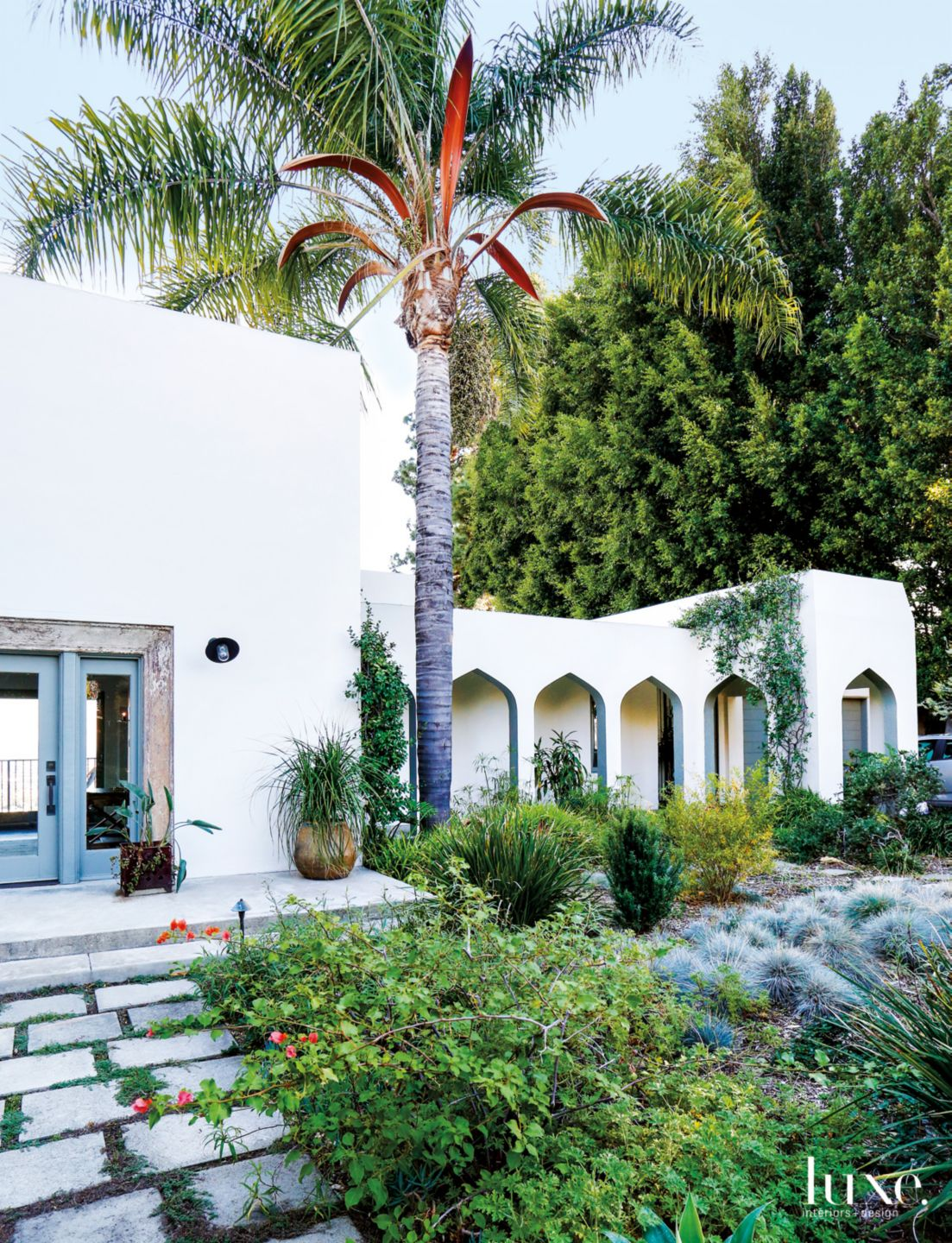 Eclectic White Exterior with Pointed Arches