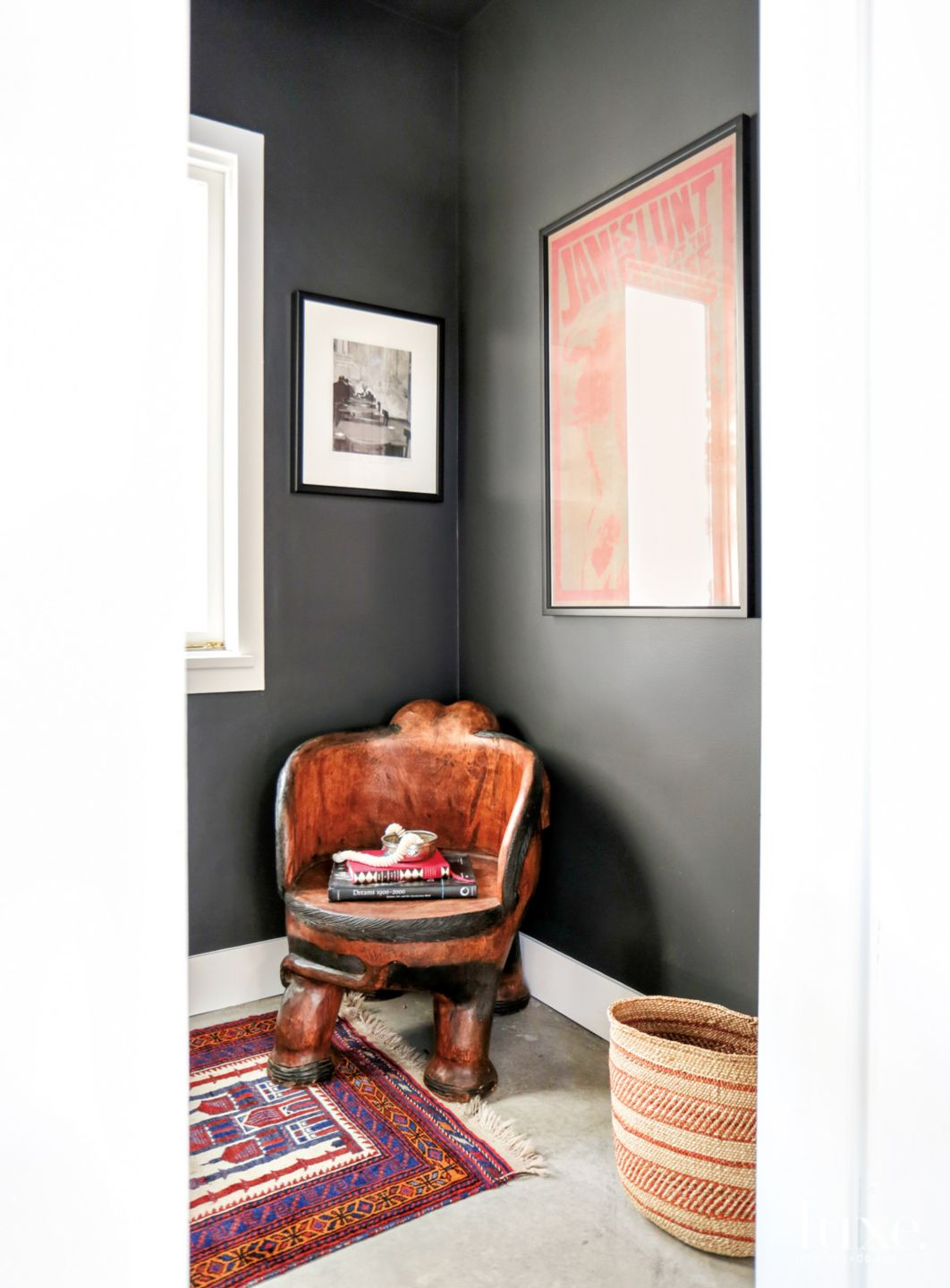 Eclectic Black Powder Room with Vintage Wood Chair