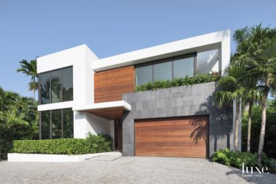 Modern white front elevation with ipe plank detail luxe