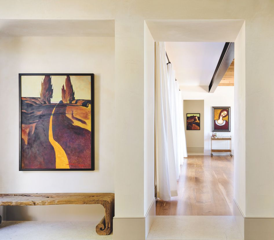 Minimalist Hall and Foyer with Limestone and Colorful Art