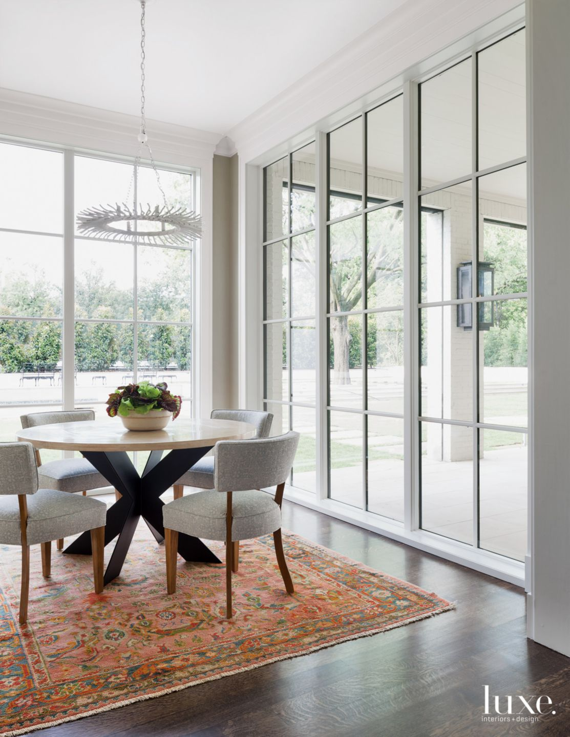 Transitional White Breakfast Area with Walls of Windows