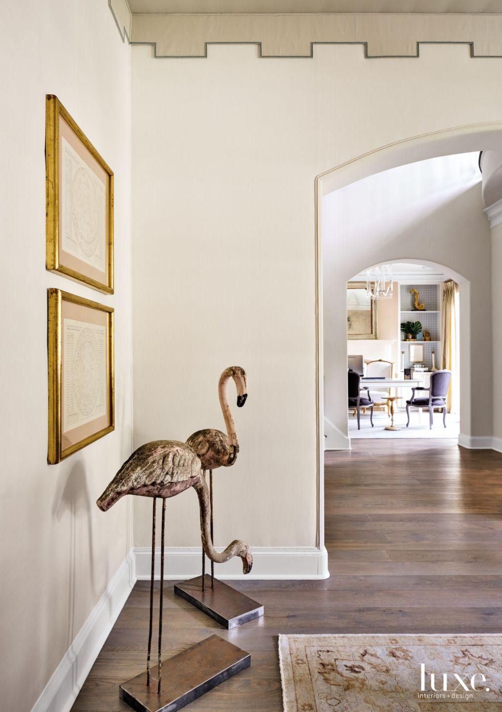 Transitional Cream Dining Room Vignette with Flamingo Statues