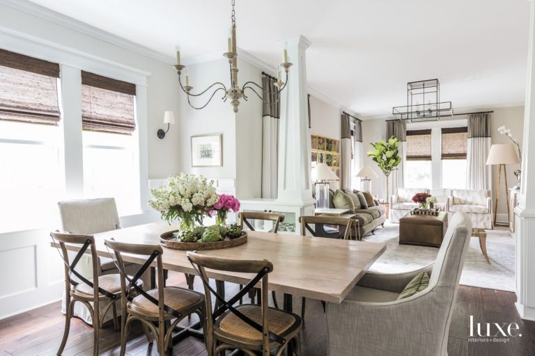 Eclectic White Dining Room With Iron And Oak Chandelier