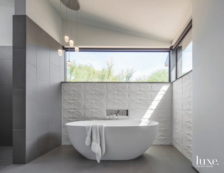 Repeated White Tile Bathroom Walls with Large Soaking Tub and High ...