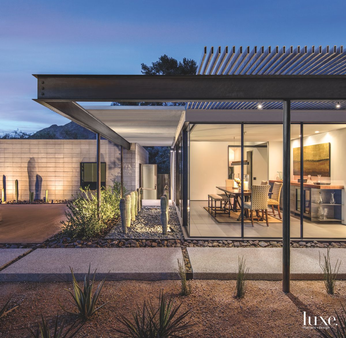 Exterior Steel Trellis Wraparound with Concrete Walkway Underneath and Cacti Rows