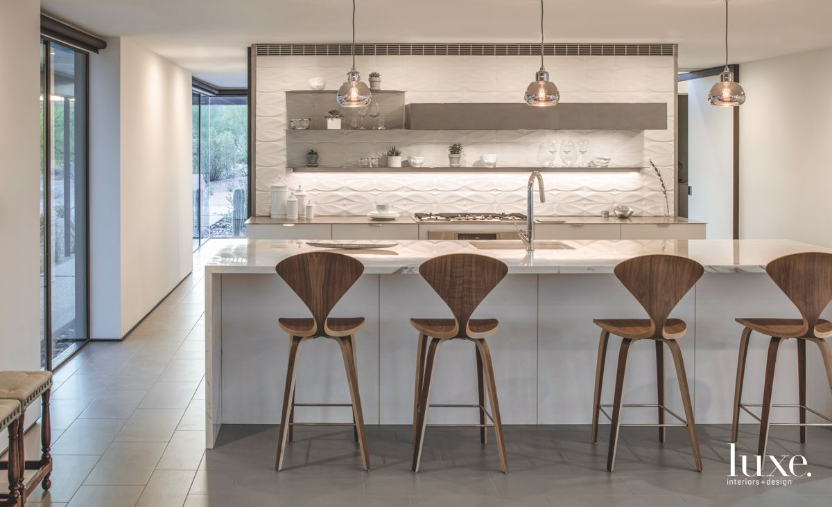 White Kitchen with Abstract Wooden Bar Stools and Metallic Pendant Lighting