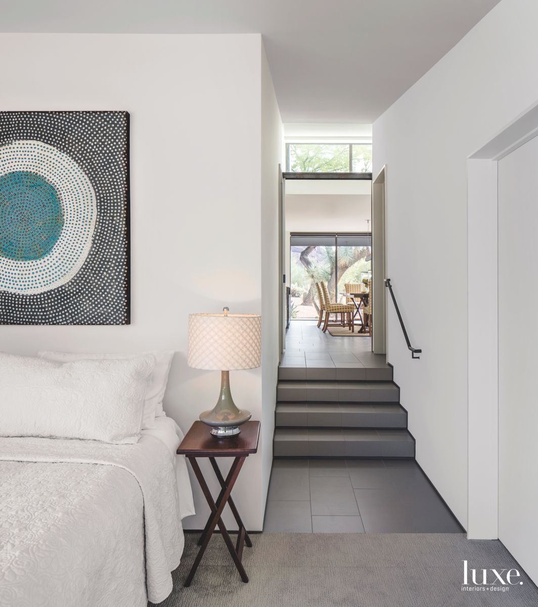 Stairs to Guest Bedroom with Circular Dot Artwork and Side Lamp