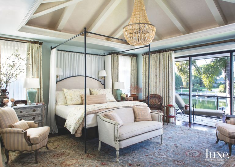 Serene High Ceiling Master Bedroom Overlooking The Water With Charming Accessories