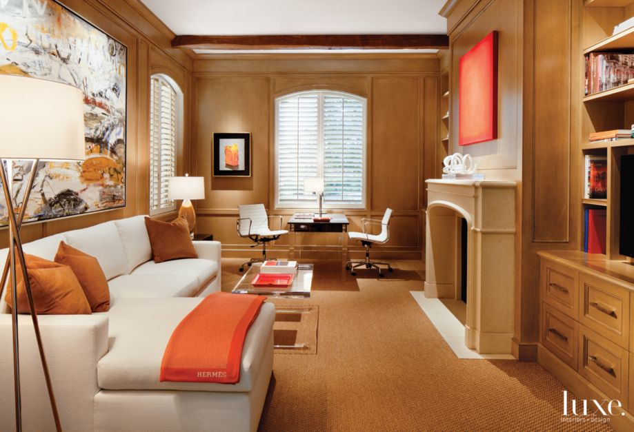 Country Neutral Library With Limestone Fireplace Surround