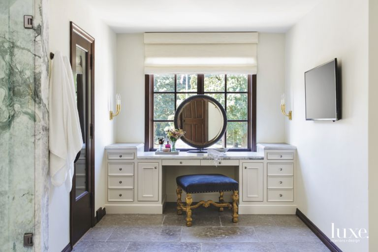 Master Bedroom Vanity with Circular Mirror, White Cabinetry, and ...