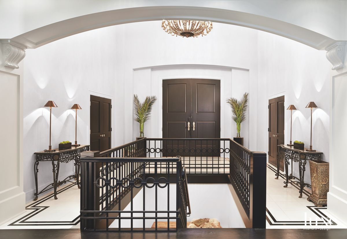 Dramatic Entrance Hall with Plants and Chandelier