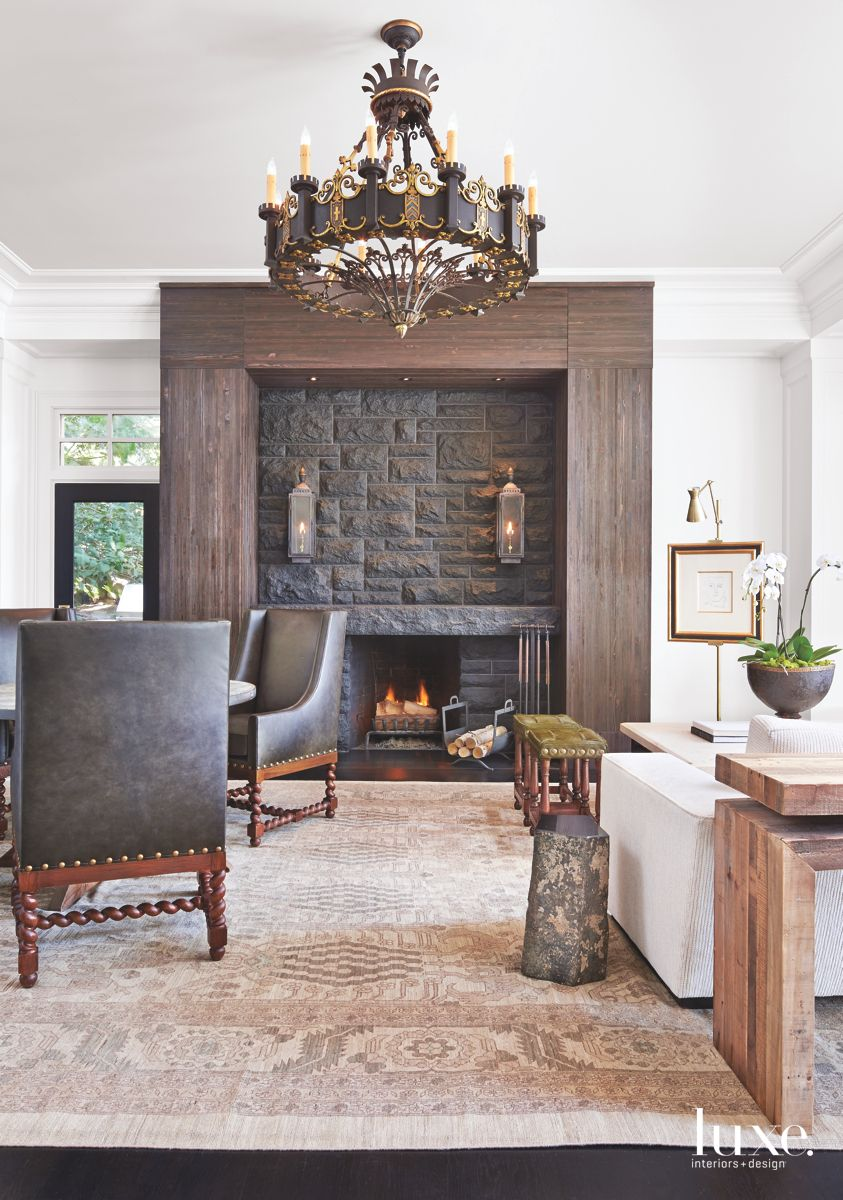 Granite and Fir Fireplace with Chandelier