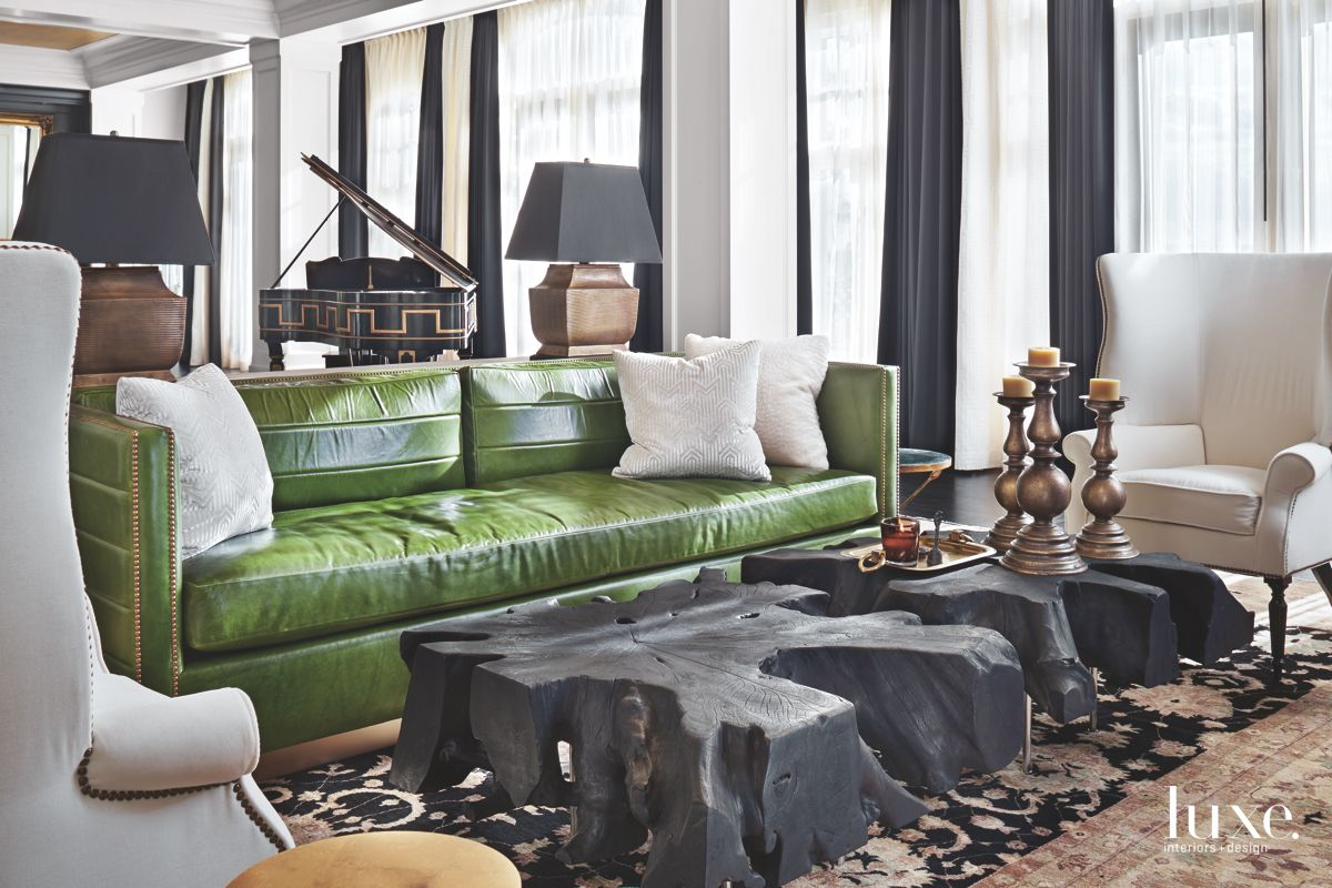 Eclectic Great Room with Wood Tables and Green Sofa