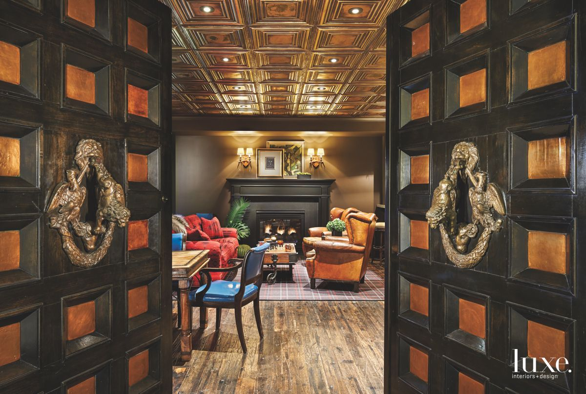 Black and Gold Whiskey Lounge with Doorknocker and Fireplace