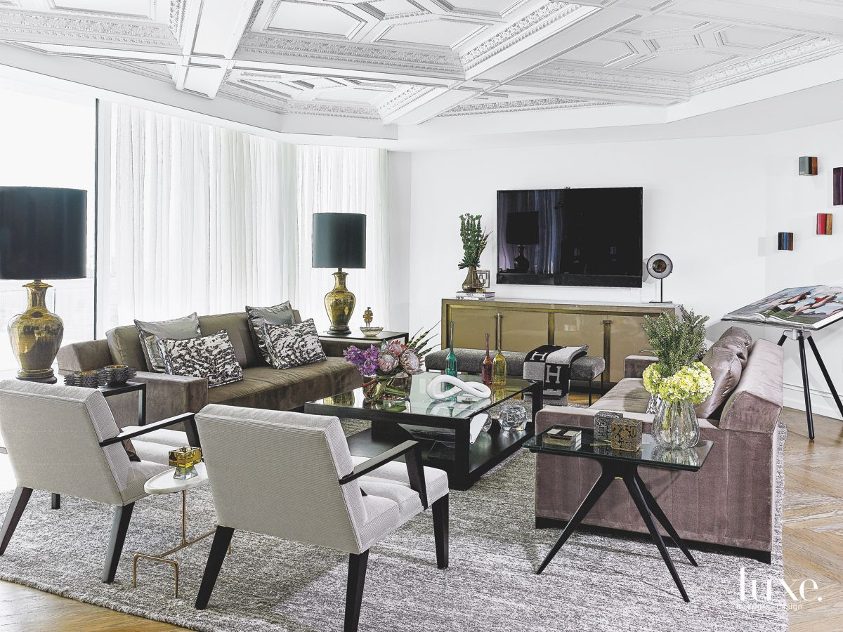 White, Modern Living Room with Large TV and Standout Fabrics