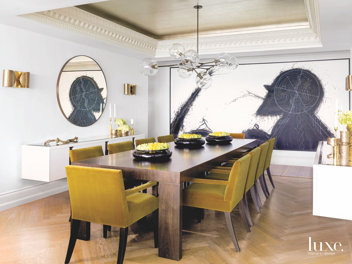 Dramatic Dining Room Painting with Color Pop Chairs
