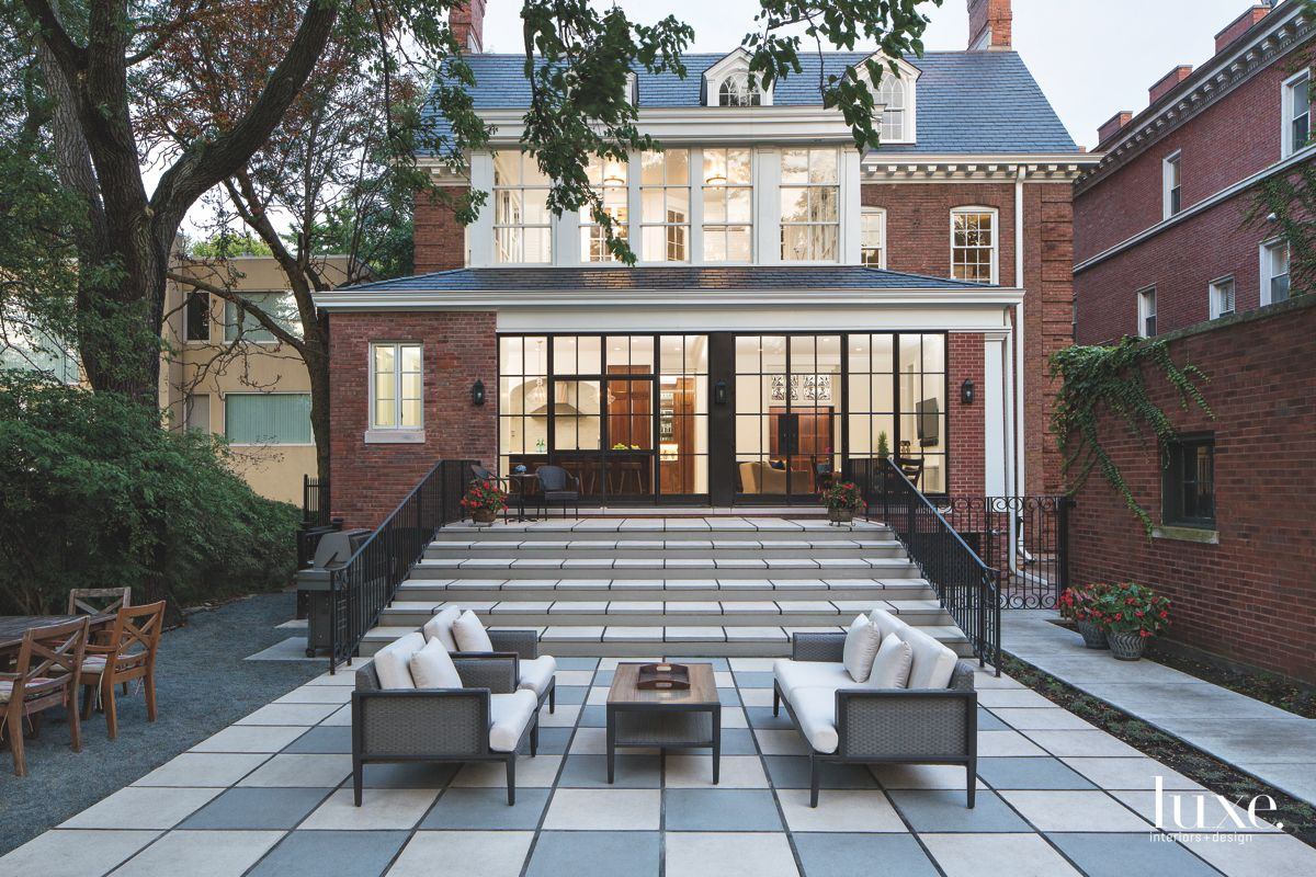 Stone Stair Rear Exterior Brick Chicago Home with Outdoor Furniture