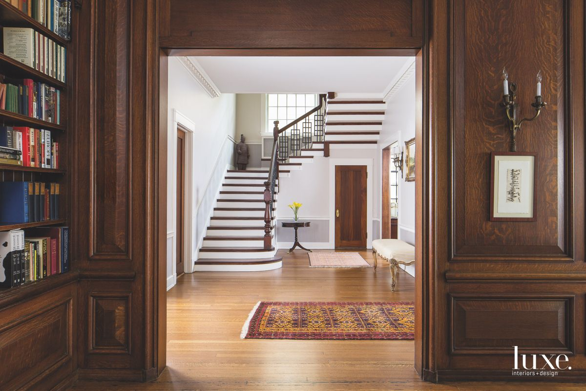 White and Brown Staircase with Runner Rug in Door Frame
