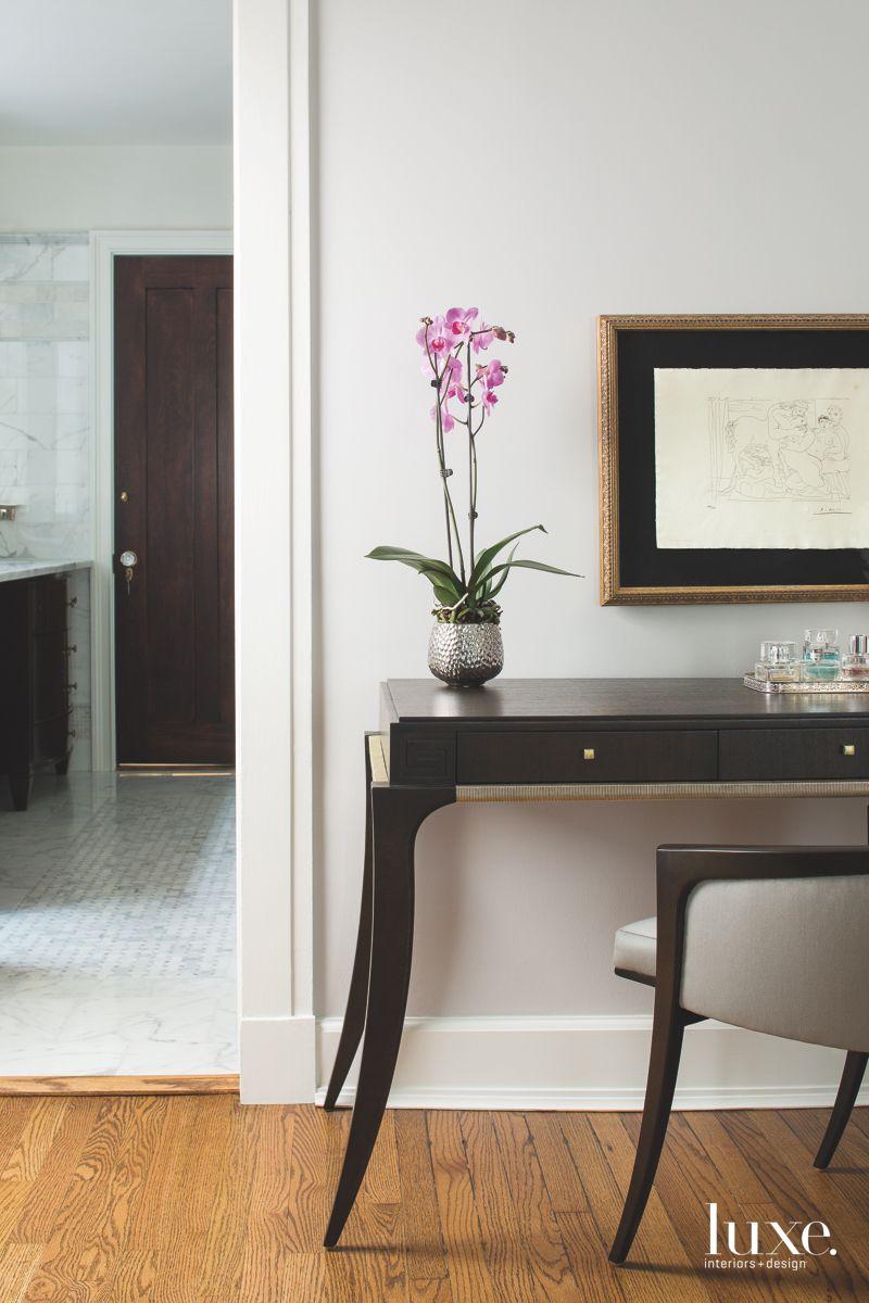 Sleek Modern Desk with Mirror and Bathroom View