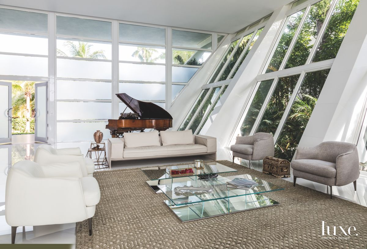 Slanted Wall and Piano White Contemporary Living Room with Sofas and Chairs