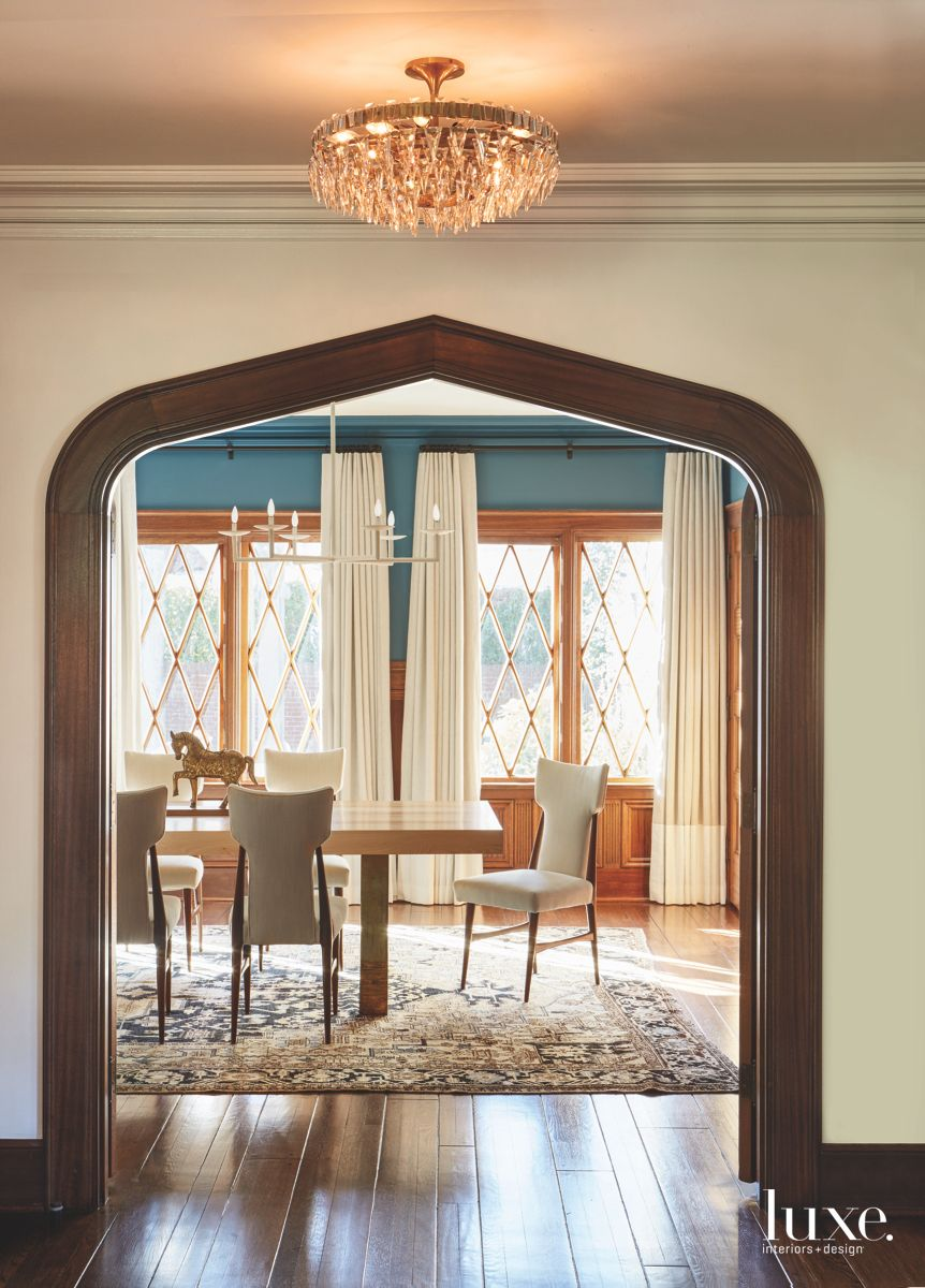 Framed Door Dining Hall Entrance with Criss Cross Windows Modern Furniture and Chandelier