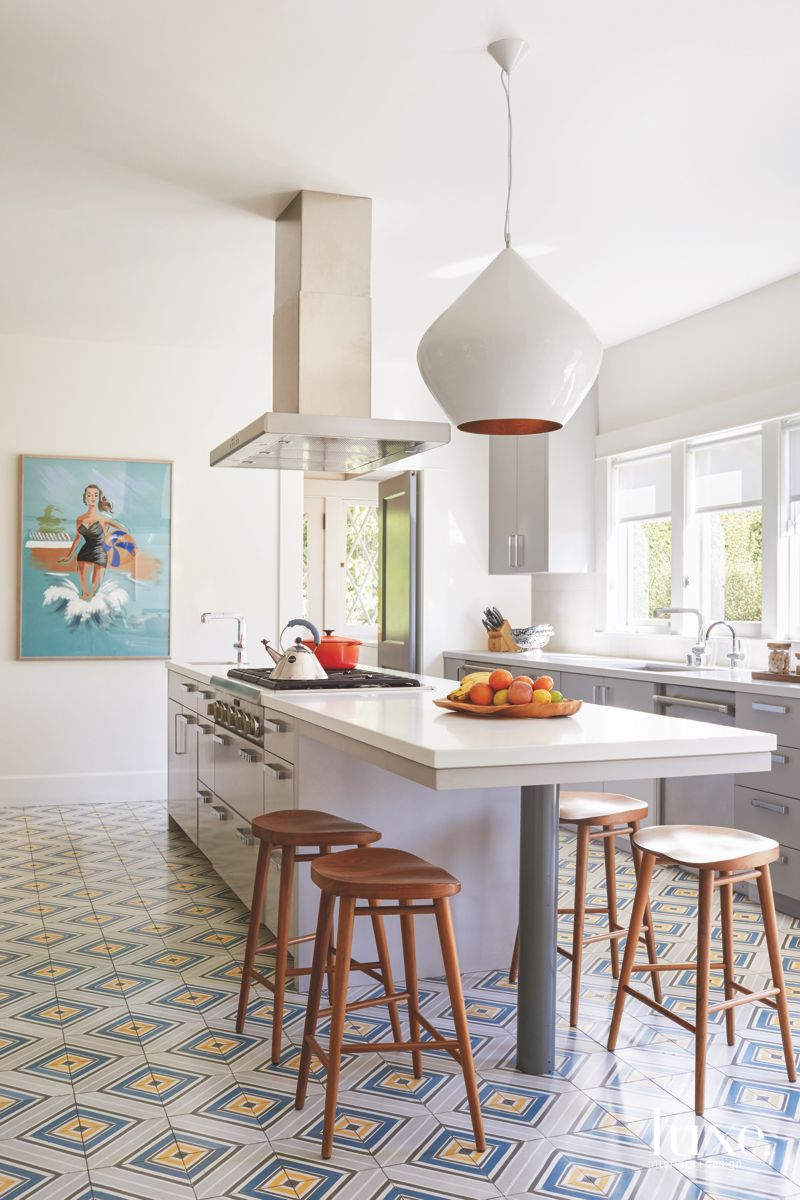 White Geometric Tile Kitchen with Bulb Lighting, Cooktop and Barstools for the Island