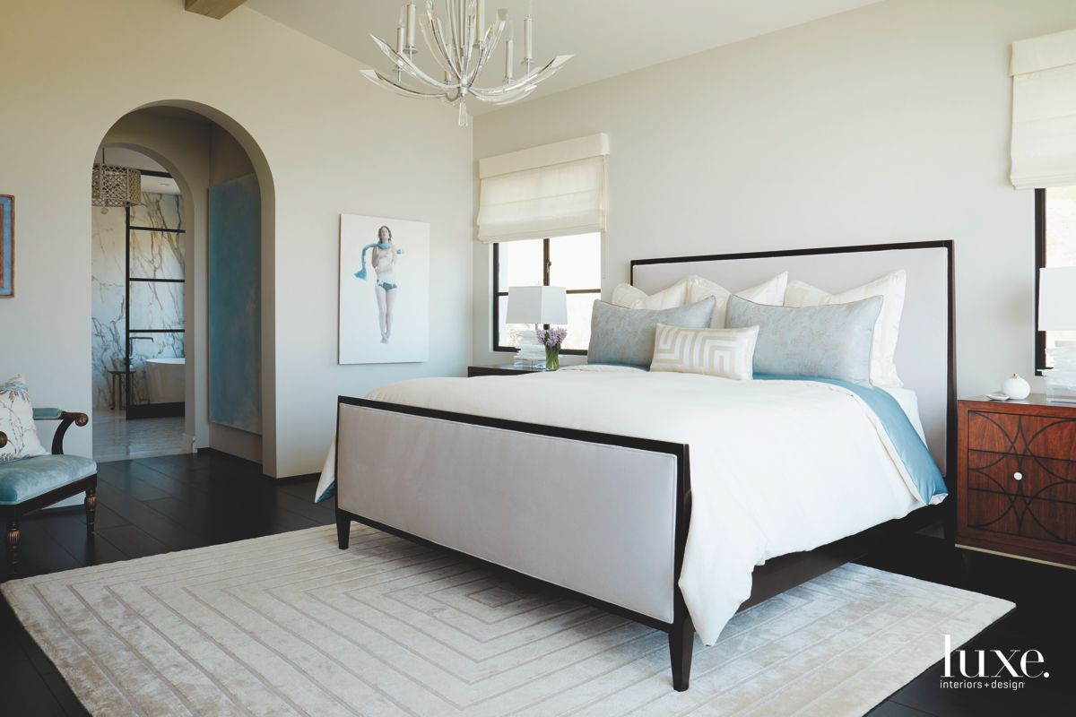 Blue Touch Bedroom with White Chandelier and Geometric Carpet
