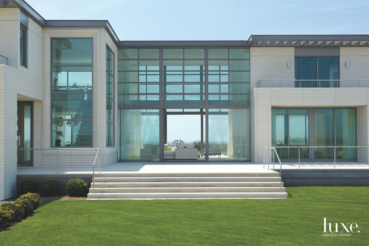 See Through Quogue Home with Contemporary Glass and Green Lawn