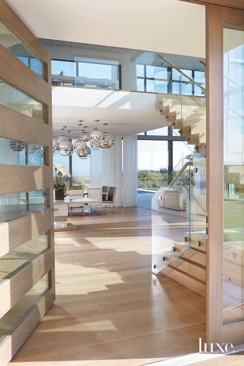 Glass and Door Entrance into a Nickel and Steel Interior