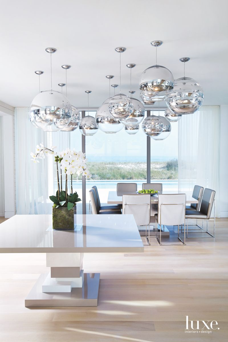 Spherical Nickel and Chrome Sitting Area and Dining Room with Ocean Views