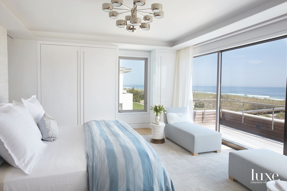 Private Balcony Blue and White Bedroom with Striped Linens