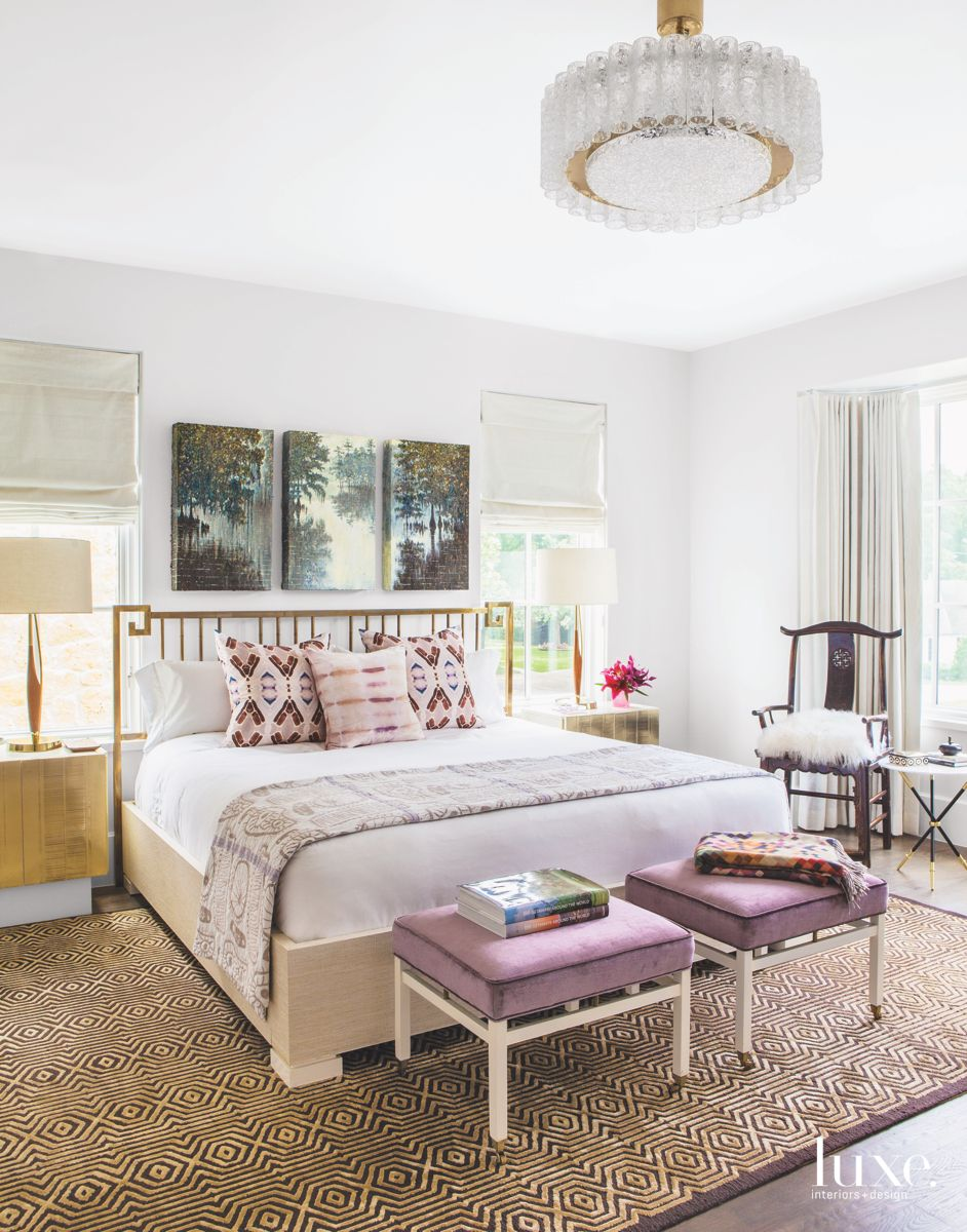 Guest Bedroom with Violet Accents, Nature Art, and Chandelier