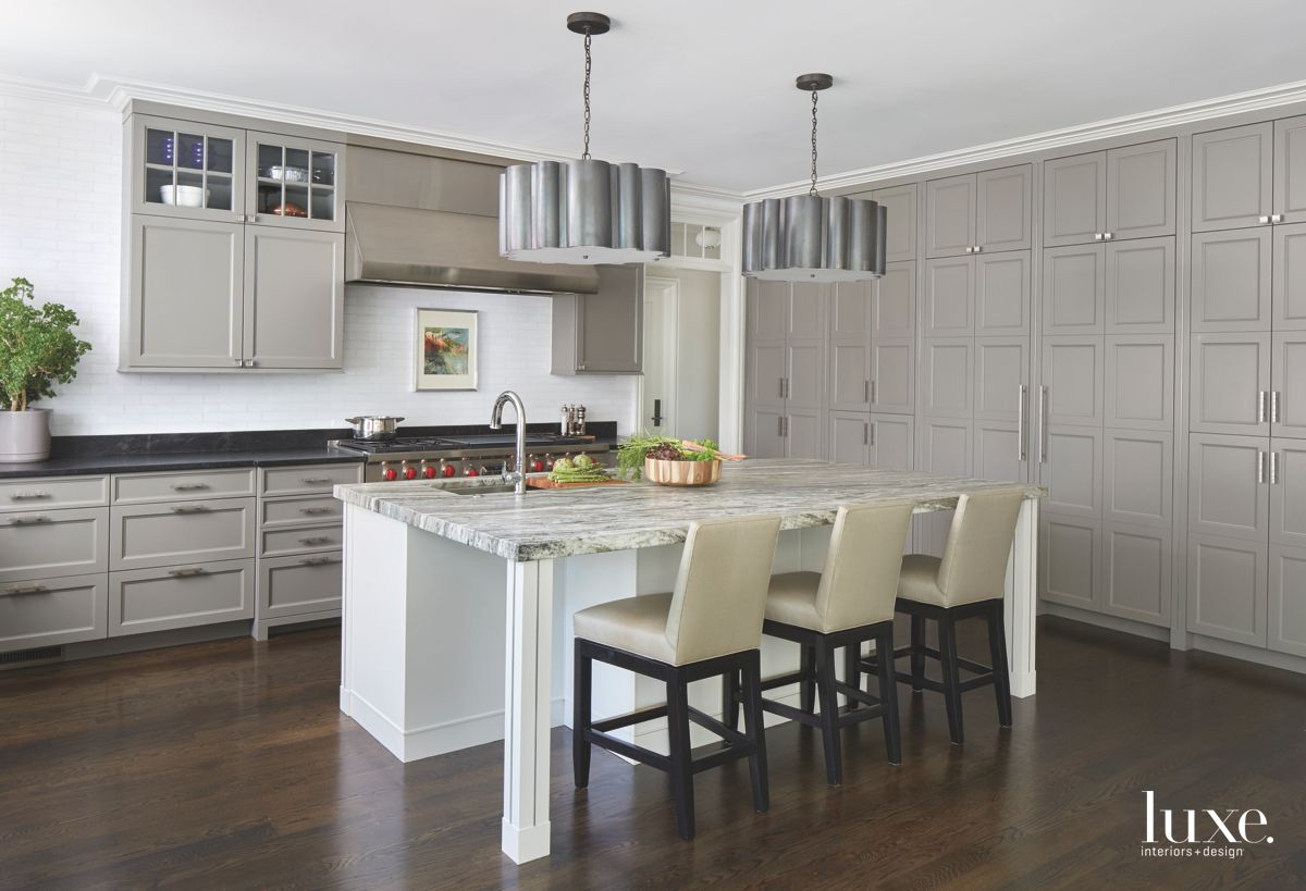 Warm Gray Kitchen with Steel Accents and Patterned Island and Bar Stools