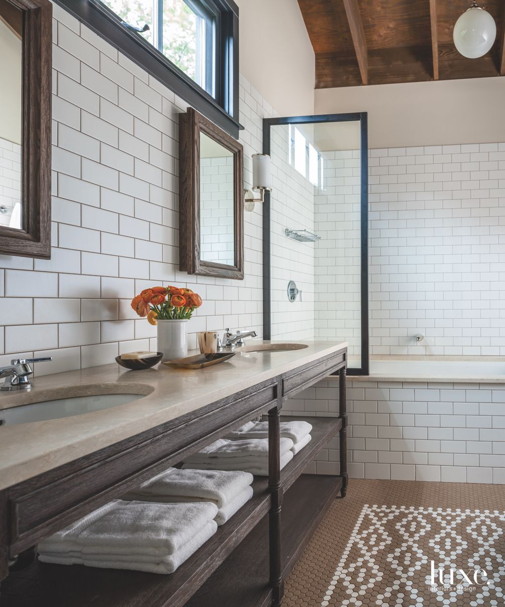 Subway Tile Master Bathroom with Vaulted Ceiling and Twin Mirrors