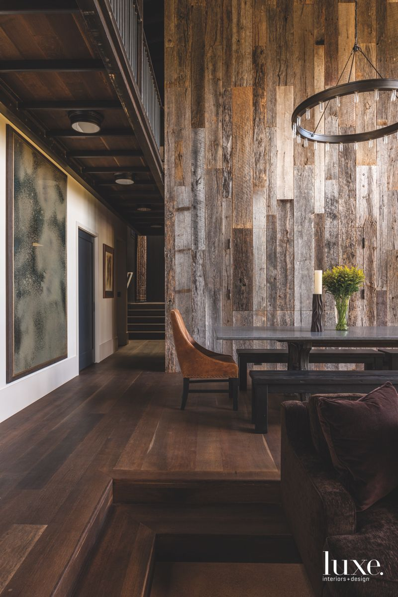 Reclaimed Wooden Wall Dining Area with Ochre Chair and Artwowrk