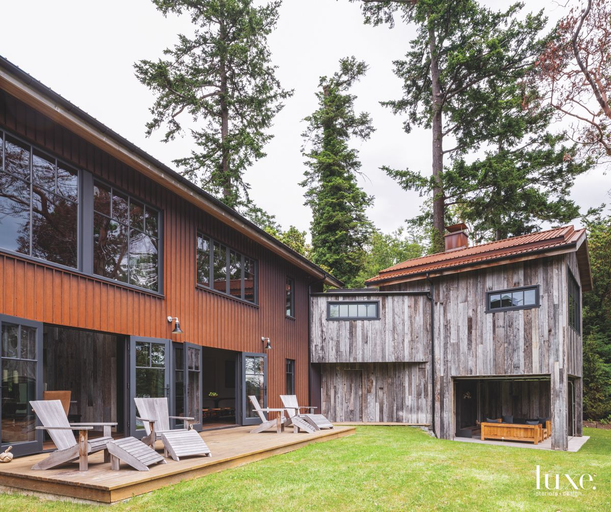 L Shaped Vertical Siding Compound Exterior with Outdoor Furniture and Outdoor Room