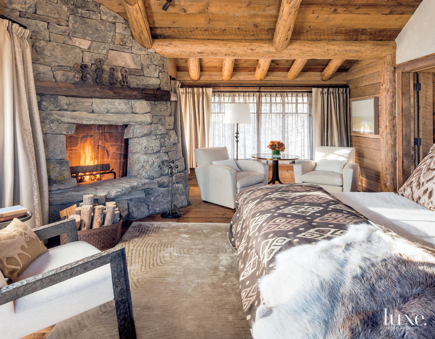 Mountain Neutral Bedroom with Stone Fireplace