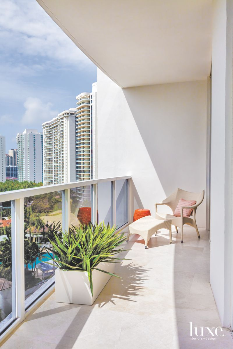 Sun-Drenched Miami Terrace with Pool View