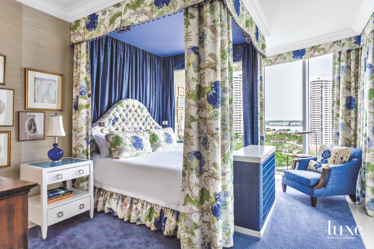 Feminine Master Bedroom with Blue and Floral Patterned Fabric