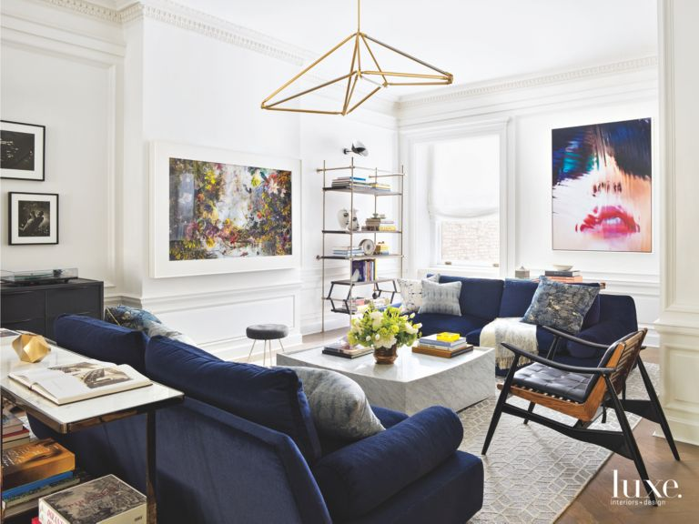 Artwork and Chandelier Parlor Room With Royal Blue Sofas Marble