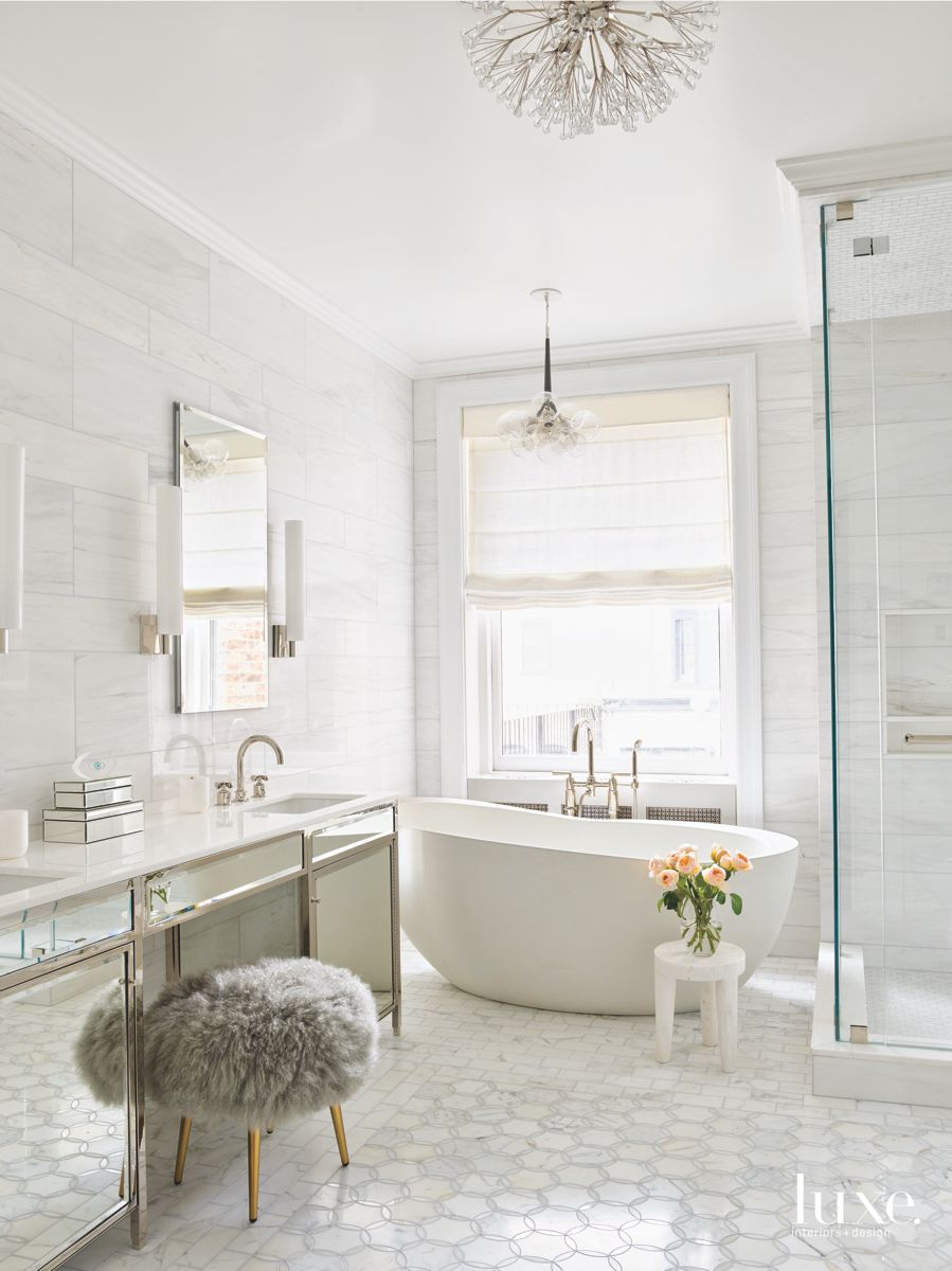Hexagonal Tile Master Bathroom with Crystal Dandelion Chandelier and Fuzzy Stool