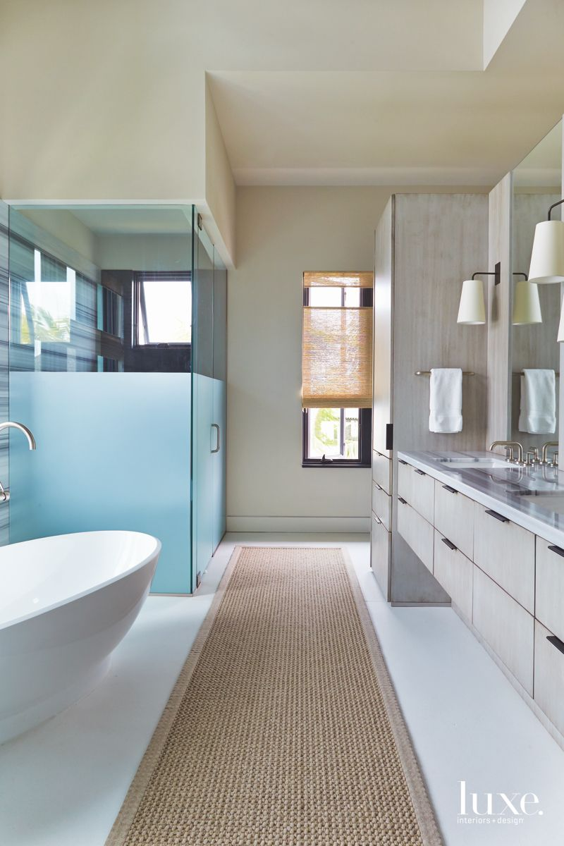 Master Bathroom with Frosted Glass Large Soaking Tub and Long Runner Rug