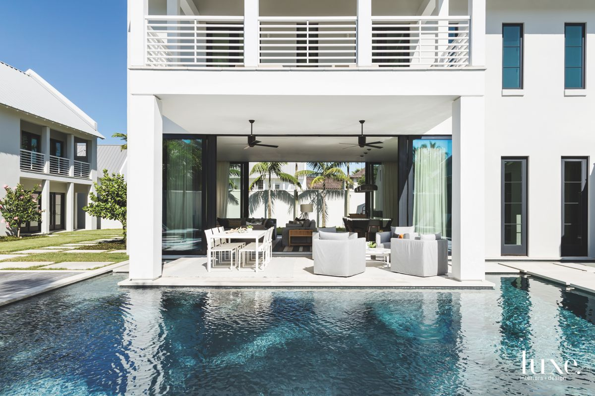 Bottom Floor Great Room Opening to Moody Pool with Outdoor Furniture