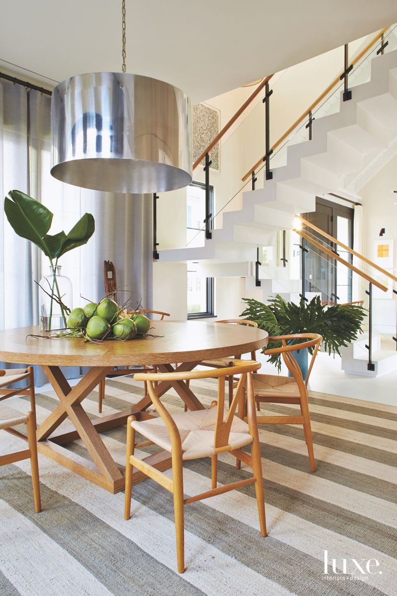 Chrome Lighting Fixture with Wooden Table and Chairs with Apples