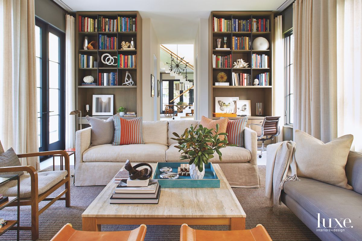 Library with Floor to Ceiling Shelving, Colorful Books and Pops of Orange