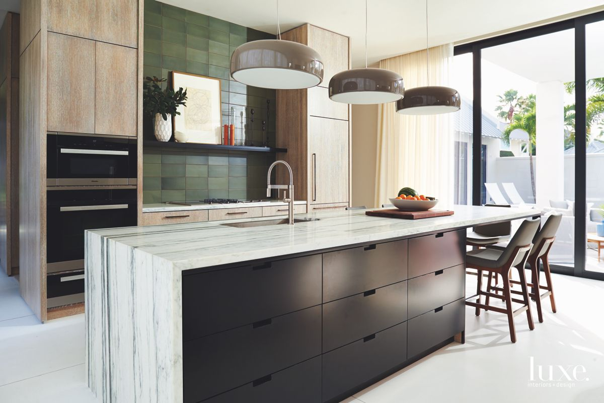 Distressed Wood Cabinet Kitchen with Striped Stone Island and Black Storage