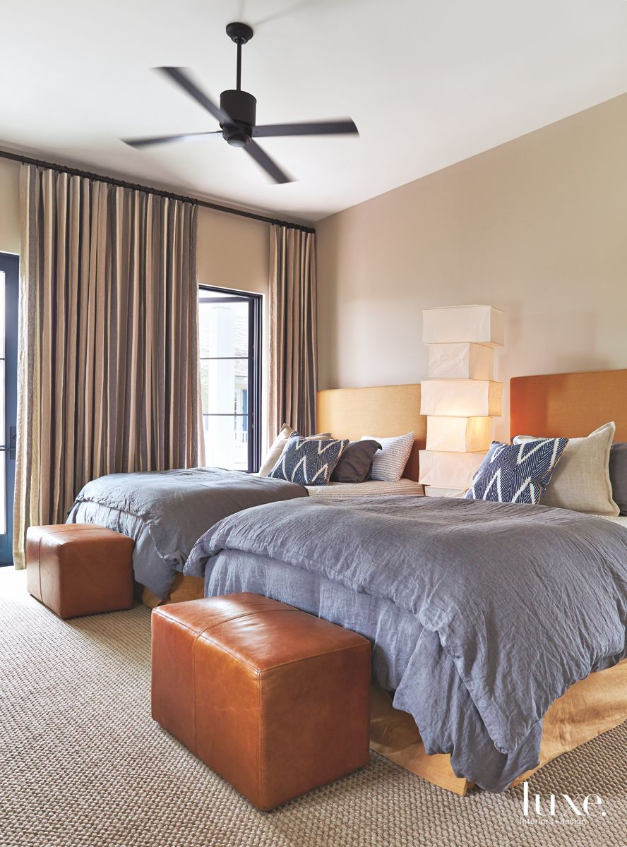 Twin Bed Guest Bedroom With Rectangular Ottomans and Ceiling Fan