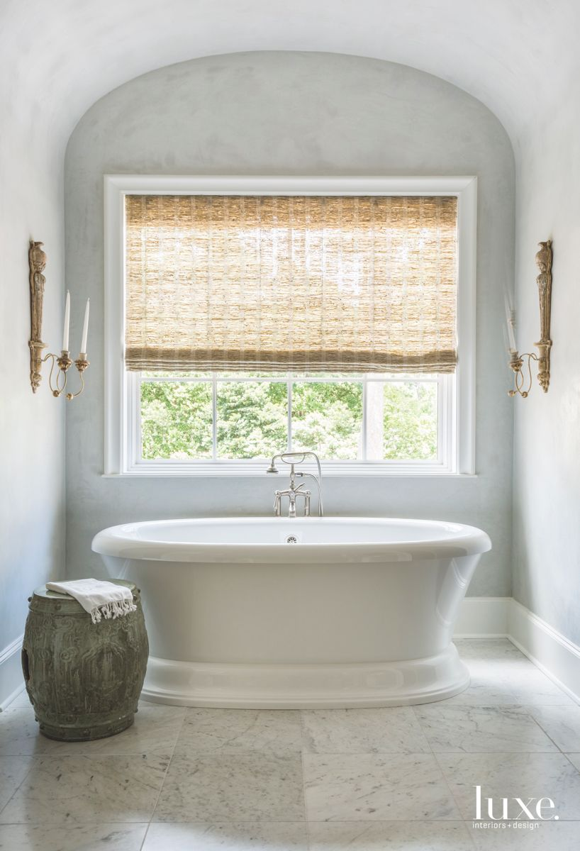 Arched Master Bathroom with Blue Walls and Large Soaking Tub
